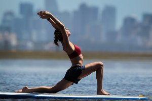 yoga-instructor-poses-during-her-paddleboard-yoga-session-Miami